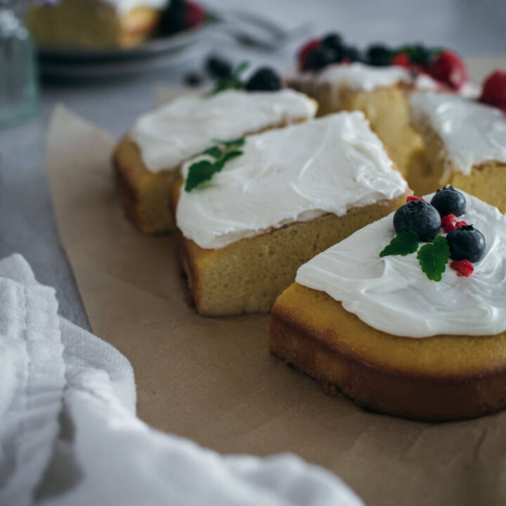 Slices of cake with icing and fruit