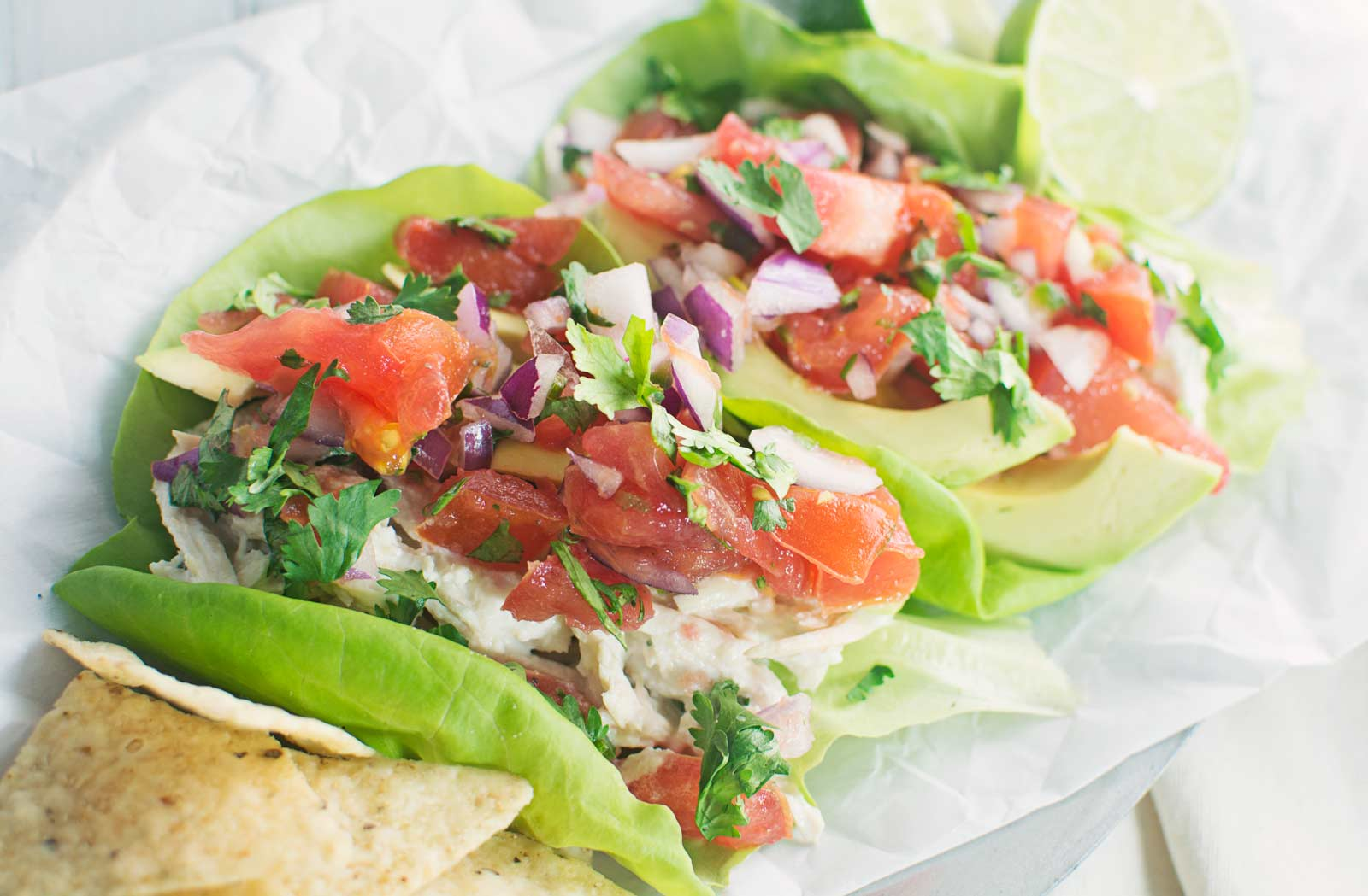 Mexican Chicken Salad with homemade Pico de Gallo served over lettuce.