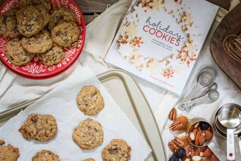 Holiday baking cookbook and a batch of cookies