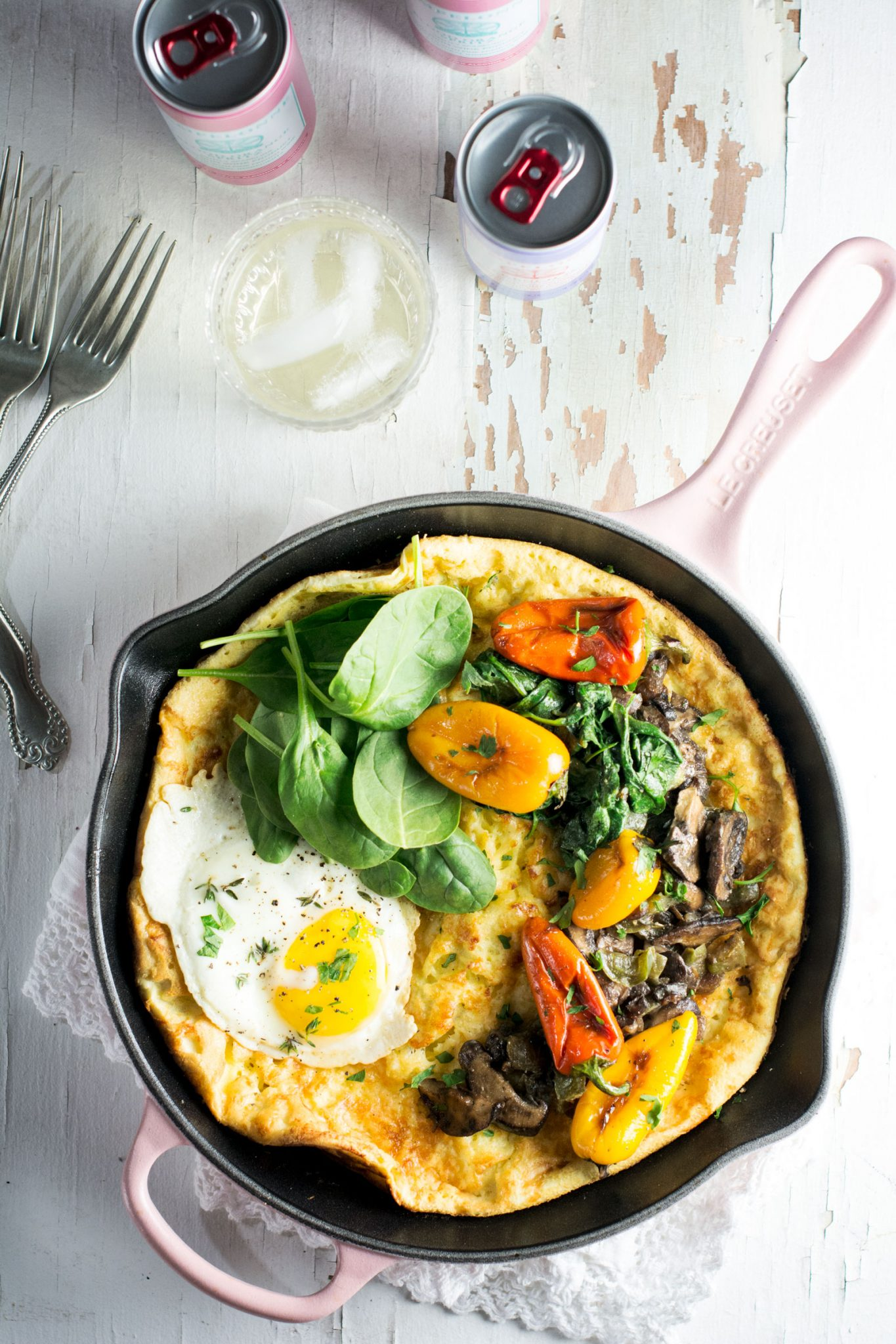 Savory Dutch Baby being served along with @enjoyPampelonne and made in my favorite skillet from @LeCreuset. Get the recipe at Little Figgy Food. #ad #LeCreusetLove #EnjoyPampelonne