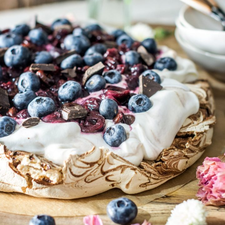 Up close and personal Chocolate Pavlova with Cherries and Blueberries. Get the Recipe at Little Figgy Food. @WorldMarket # #worldmarkettribe #ad