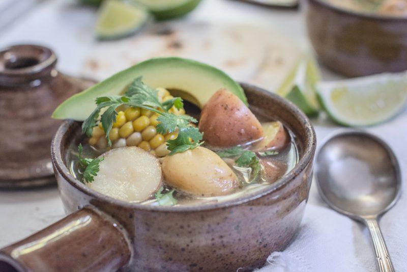 Ajiaco - Chicken Corn and Potato Stew with avocado slices