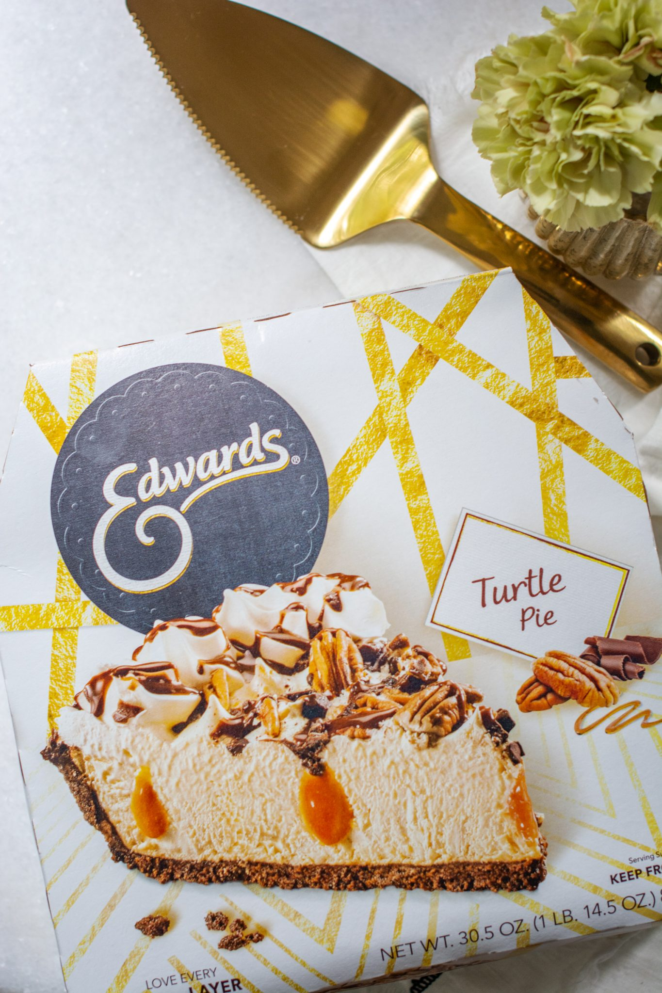 Edwards turtle pie package with gold pie slicer and flowers