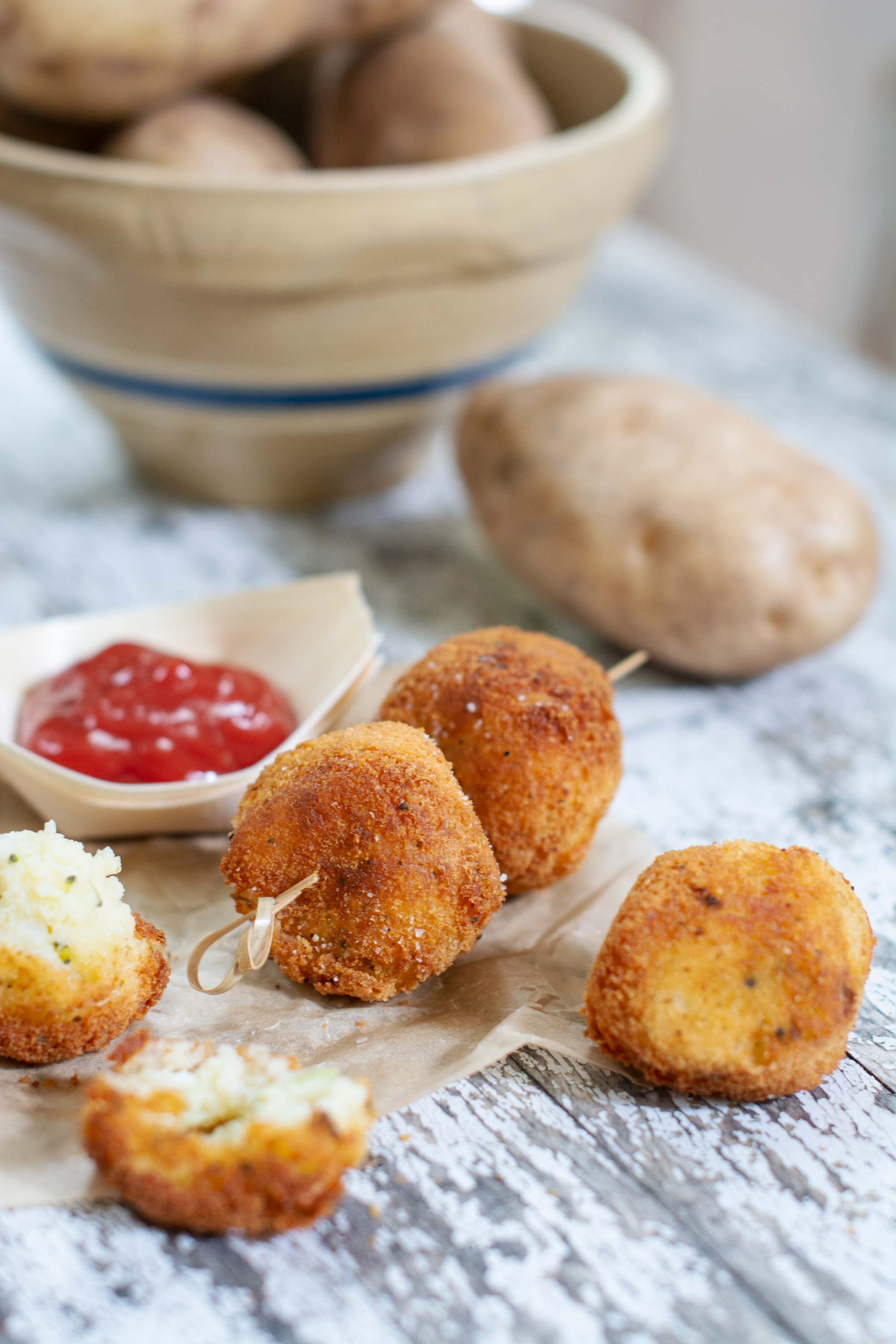 Ketchup with mashed vegetable balls and ketchup on white table