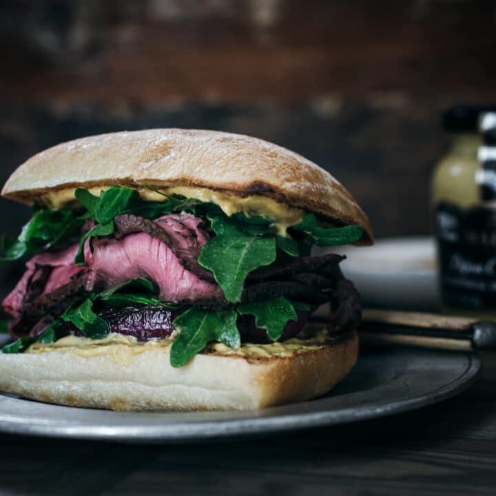 Sliced steak and caramelized onion ciabatta sandwich