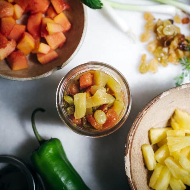 Jar of pineapple salsa and ingredients