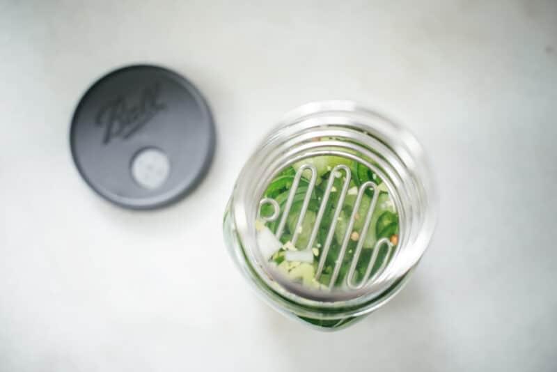 Spring pushing veg down in fermentation jar