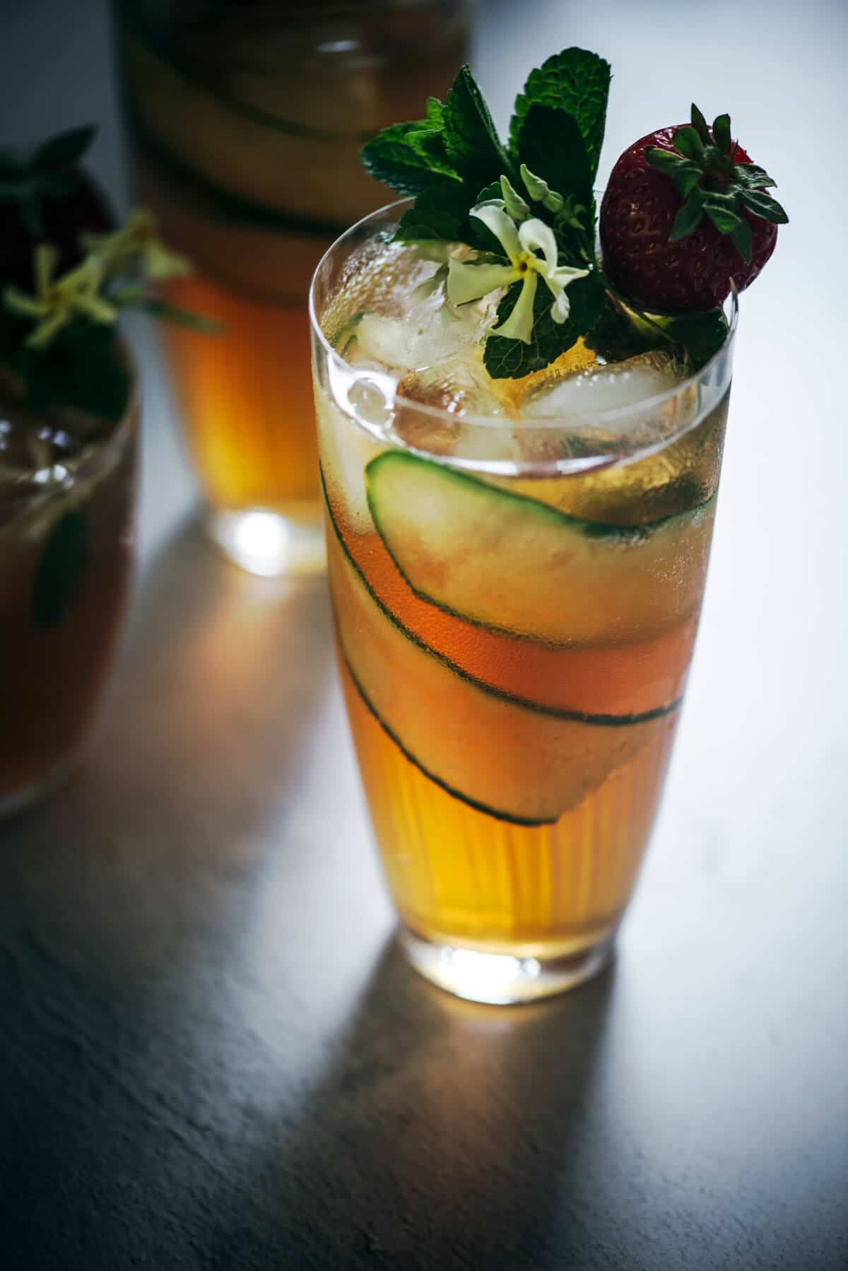 High ball glass with cocktail and garnishes