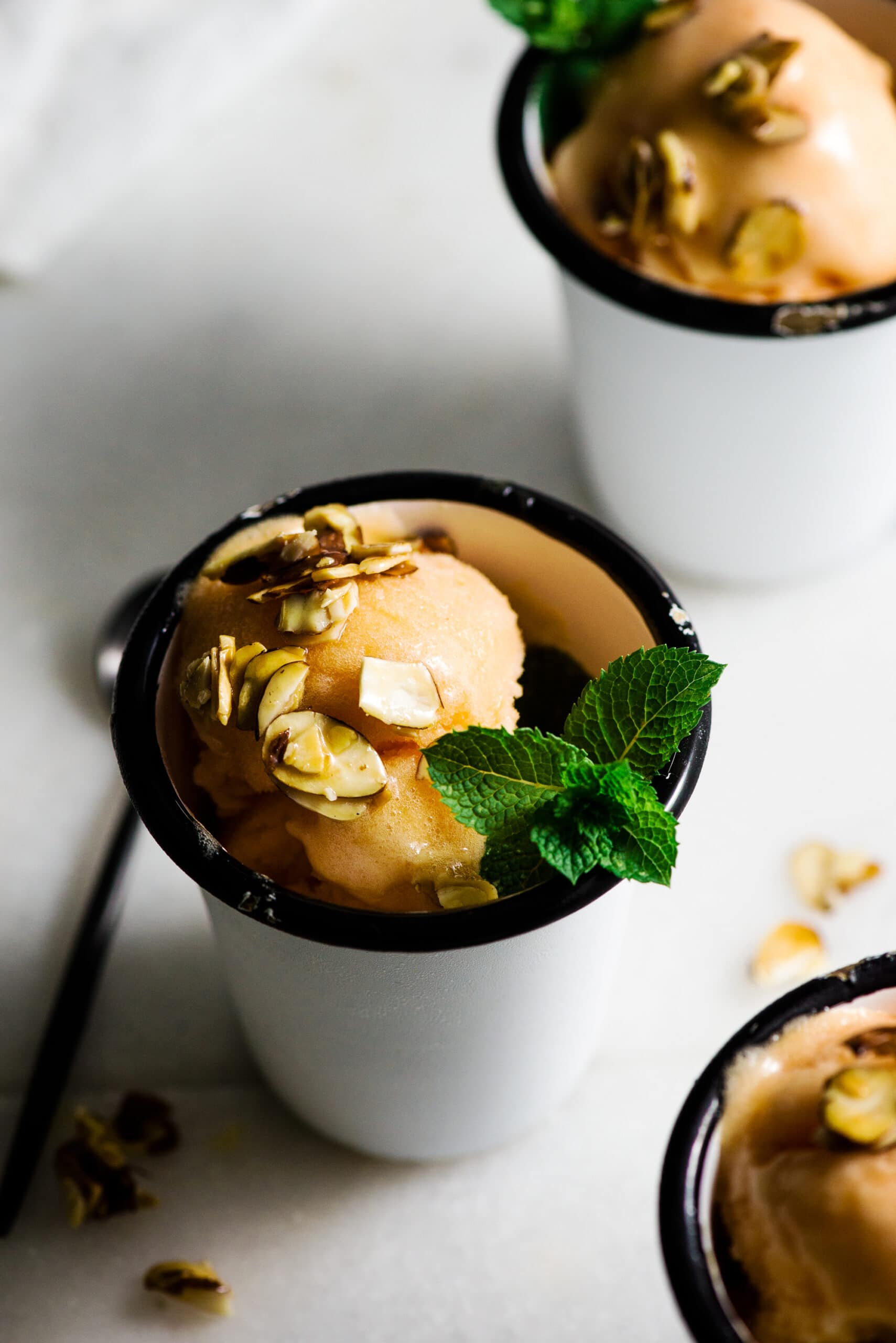 serving fresh sorbet recipe with mint sprigs